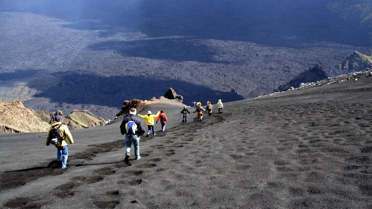 climbing to the top of Mount Etna