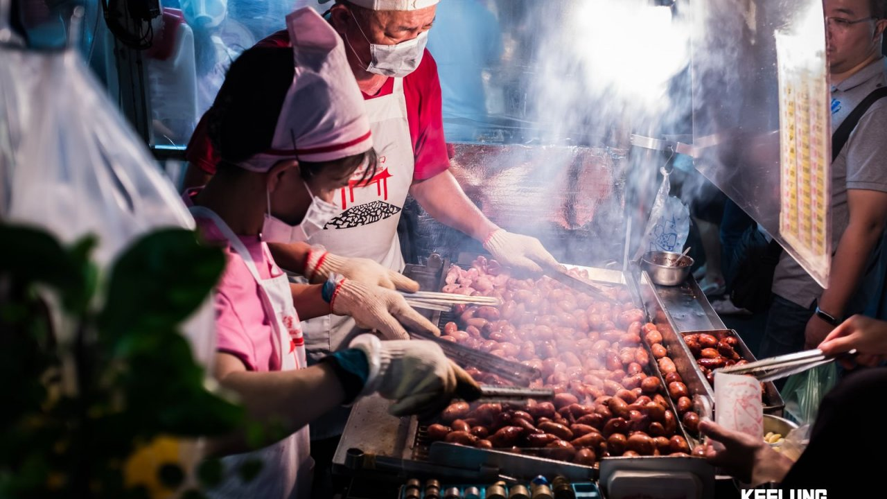 Taiwanese sausages sizzling on the grill!